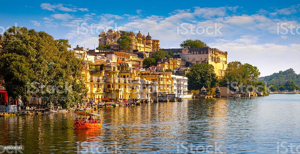 City Palace and Pichola lake in Udaipur, India stock photo