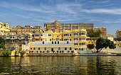 Udaipur, India, November 29, 2015: View of the City Palace which is the landmark of the city. The famous palace is a complex situated on the east bank of Lake Pichola. The palace was built over a period of nearly 400 years, with contributions from several rulers of the Mewar dynasty. Its construction began in 1553.