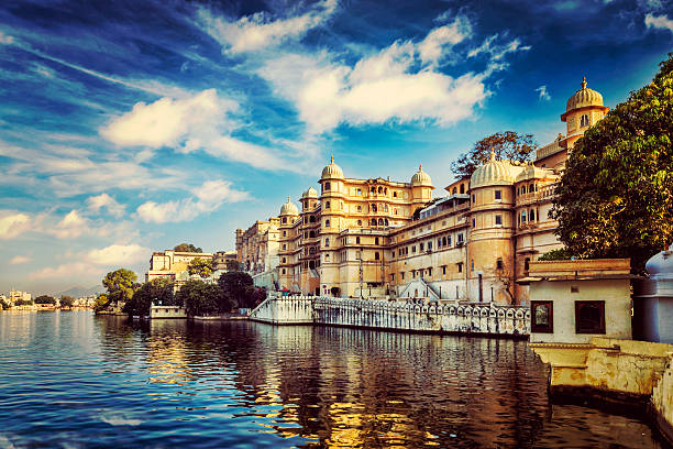 City Palace. Udaipur, India Romantic India luxury tourism wallpaper  - Vintage retro effect filtered hipster style image of Udaipur City Palace and Lake Pichola. Udaipur, Rajasthan, India lake pichola stock pictures, royalty-free photos & images