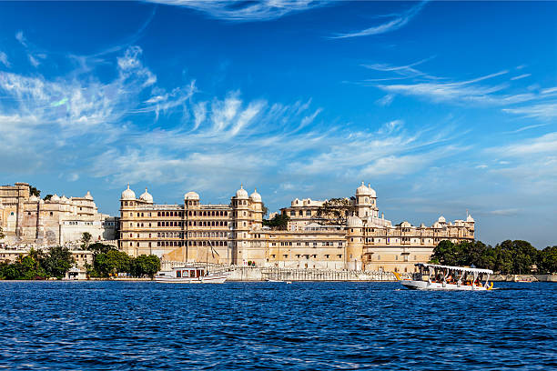 City Palace view from the lake. Udaipur, Rajasthan, India India luxury tourism concept background - Udaipur City Palace from Lake Pichola. Udaipur, Rajasthan, India lake pichola stock pictures, royalty-free photos & images