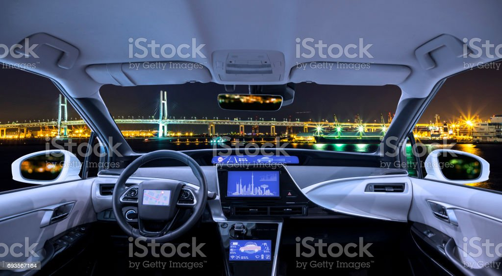 city panorama view looking form empty car cockpit, various screens and heads up displays stock photo