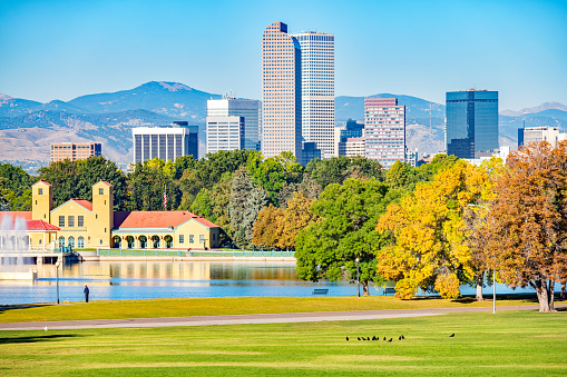 Stock photograph of City Park with Ferril Lake and the skyline of Denver Colorado USA during Autumn.