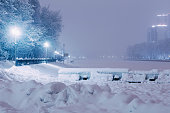 City park by the river covered in snow
