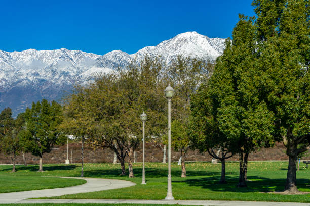 City park in Rancho Cucamonga with a view of  snow capped mountains. stock photo