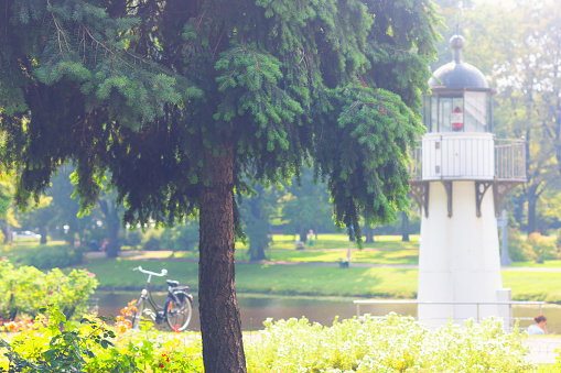 City park with a lighthouse on the canal and bicycle