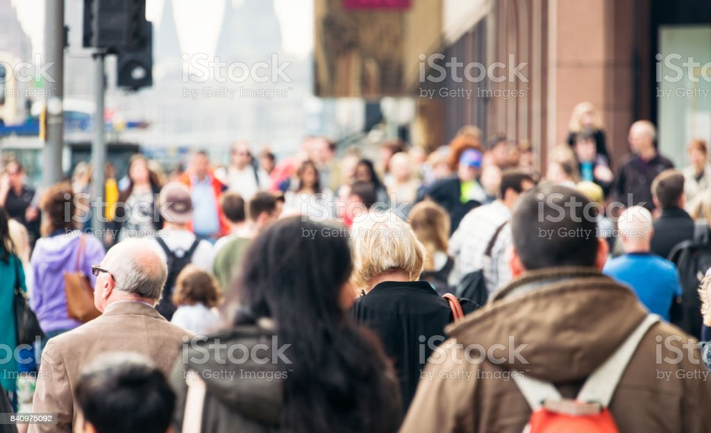 CIty pavement busy with pedestrians royalty-free stock photo
