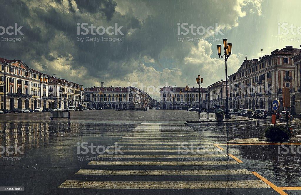 City plaza at rainy day in Cuneo, Italy. stock photo