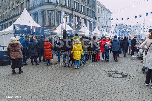 City Riga, Latvia. Street Restaurant food festival. Peoples walking and taste food. 18.01.2020
