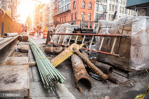 City road construction site with water tubes pipeline replacement