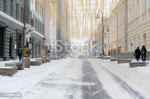 istock city road covered with snow with cars on the sidelines in winter season b 1126963292