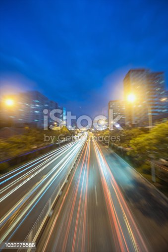istock city road in radial blur in night with lights on 1032275586