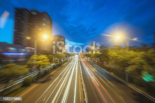 istock city road in radial blur in night with lights on 1032275860