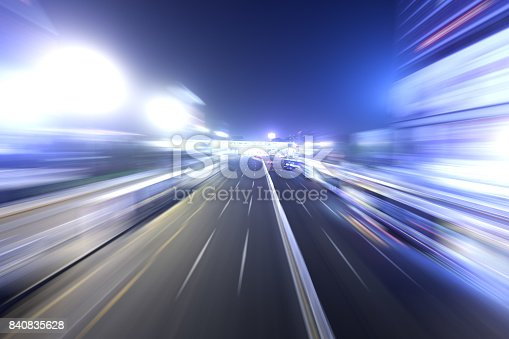 istock city road in radial blur in night with lights on 840835628