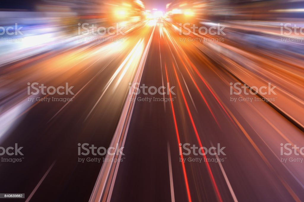 city road in radial blur in night with lights on stock photo