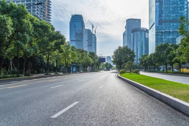 City road through modern buildings in beijing Road, Street, Highway, Capital Cities, City Street street stock pictures, royalty-free photos & images