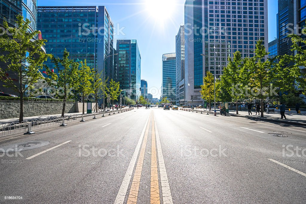 city road through modern buildings in beijing stock photo