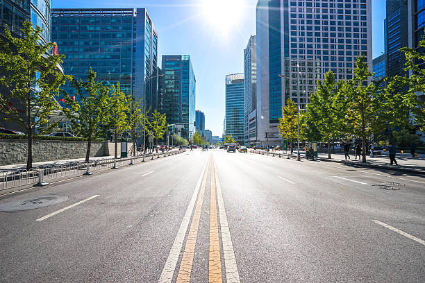 city road through modern buildings in beijing - midsection stock pictures, royalty-free photos & images
