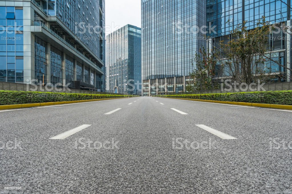 City road through modern buildings in china stock photo