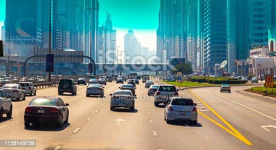 Dubai, UAE - November 29, 2018: Urban roads through the front window of the car. Sheikh Zayed Rd.