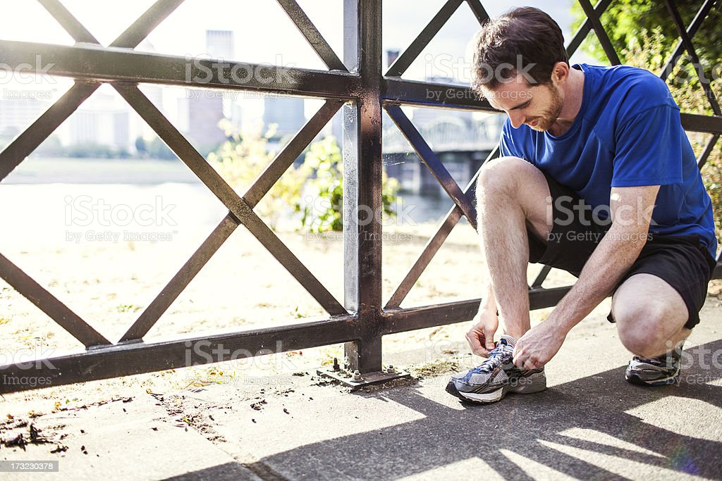 City Runner Tying Shoe royalty-free stock photo