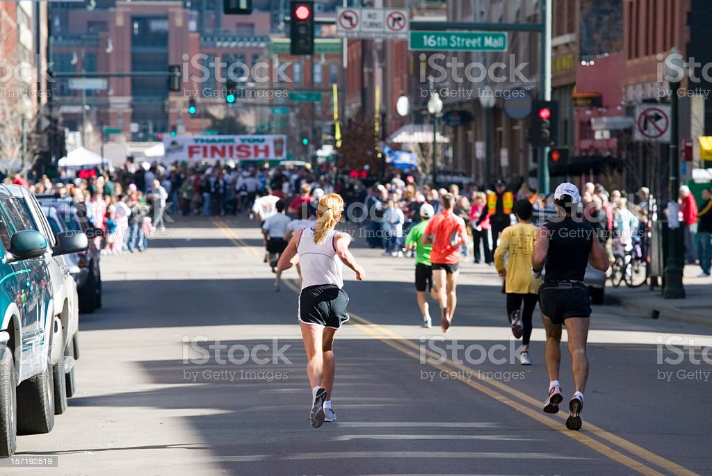 City running race with finish line in sight stock photo