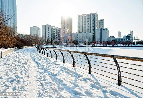 istock City sidewalk in snowy day 1292123073