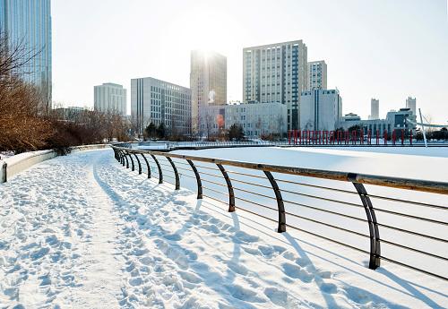 City sidewalk in snowy day.