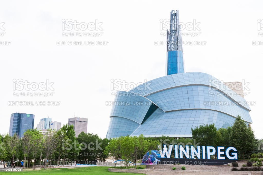 City Sign and Canadian Museum of Human Rights in Winnipeg, Manitoba, Canada stock photo