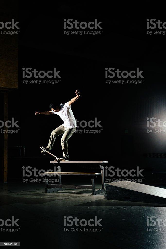 City Skateboarder Skating Ledge at a Skatepark stock photo