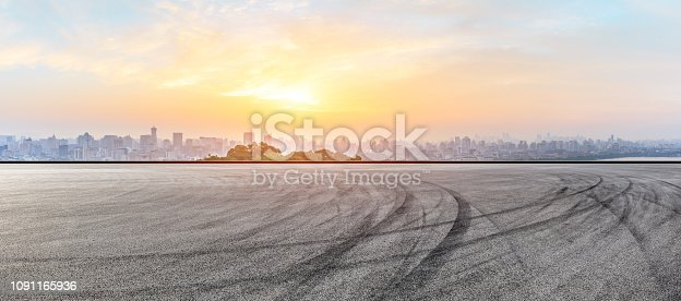 613763122 istock photo City skyline and buildings with empty asphalt road at sunrise 1091165936