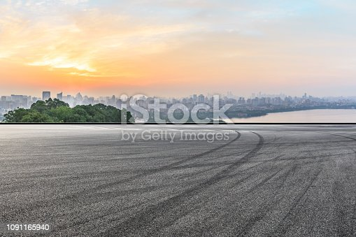 613763122 istock photo City skyline and buildings with empty asphalt road at sunrise 1091165940