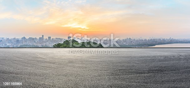 613763122 istock photo City skyline and buildings with empty asphalt road at sunrise 1091165964