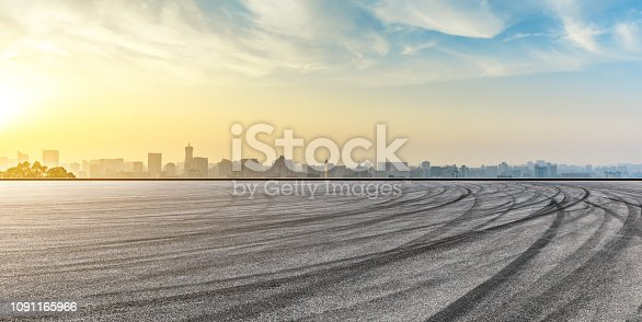 613763122 istock photo City skyline and buildings with empty asphalt road at sunrise 1091165966