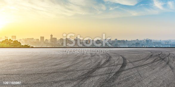 613763122 istock photo City skyline and buildings with empty asphalt road at sunrise 1091165982