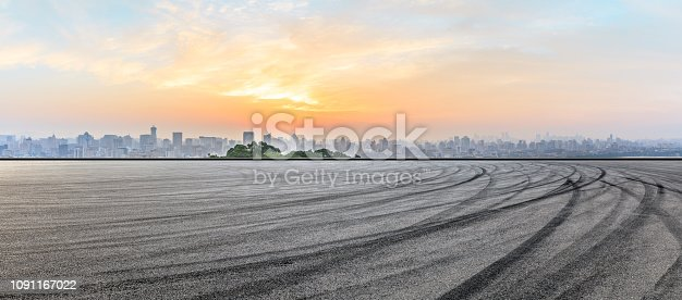 613763122 istock photo City skyline and buildings with empty asphalt road at sunrise 1091167022
