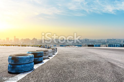 613763122 istock photo City skyline and buildings with empty asphalt road at sunrise 1091167070