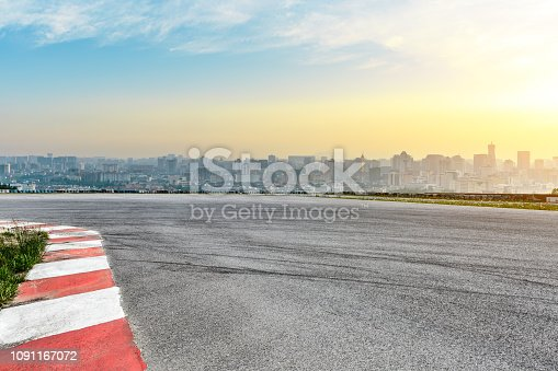 613763122 istock photo City skyline and buildings with empty asphalt road at sunrise 1091167072