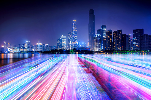 city skyline and light line on the river