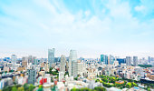 city skyline bird eye aerial view from tokyo tower under dramatic sunny and morning blue cloudy sky in Tokyo, Japan. Miniature Tilt-shift effect
