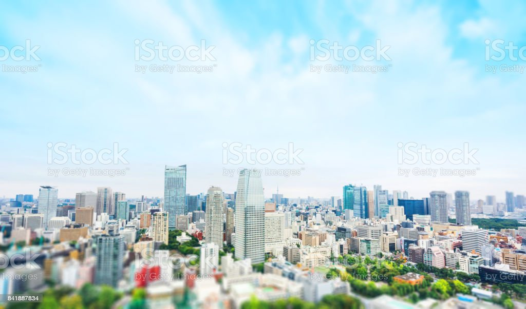 city skyline bird eye aerial view from tokyo tower under dramatic sunny and morning blue cloudy sky in Tokyo, Japan. Miniature Tilt-shift effect stock photo