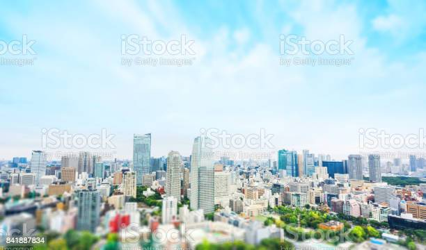 Business and culture concept - panoramic modern city skyline bird eye aerial view from tokyo tower under dramatic sunny and morning blue cloudy sky in Tokyo, Japan. Miniature Tilt-shift effect