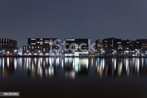 City skyline illuminated at night, Amsterdam, The Netherlands