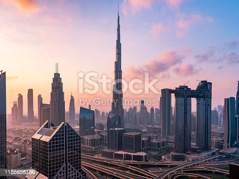 Dubai sky line with traffic junction and Burj Khalifa.