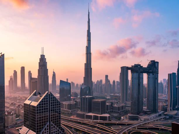City skyline in Dubai Dubai sky line with traffic junction and Burj Khalifa. burj khalifa stock pictures, royalty-free photos & images
