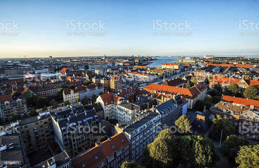 City skyline of Copenhagen at sunset with blue sky stock photo