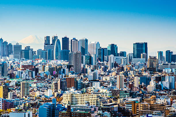city skyline of tokyo japan on a sunny day - shinjuku ward stock photos and pictures