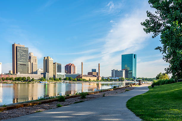 City Skyline A panoramic view of downtown Toledo Ohio's skyline from across the Maumee river at a popular local park.  A beautiful  blue sky with white clouds for a backdrop. ohio stock pictures, royalty-free photos & images