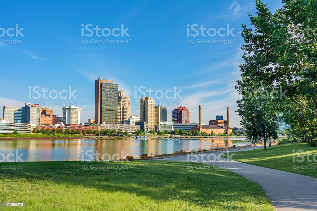 A city skyline reflected in a smooth lake surface stock photo