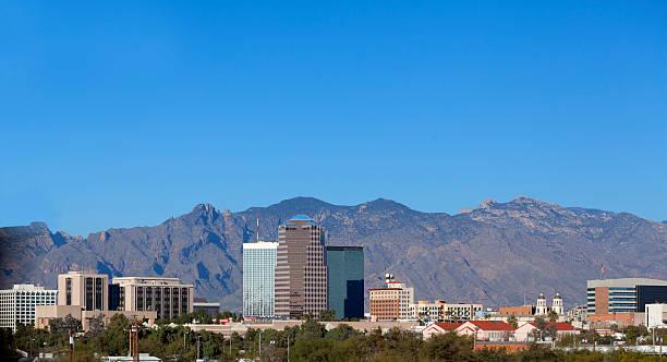 City skyline, Tucson, AZ Cityscape of Tucson downtown against mountain range, Arizona tucson stock pictures, royalty-free photos & images