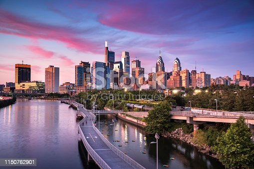 Downtown city skyline view of Philadelphia Pennsylvania USA over the Schuylkill River and boardwalk